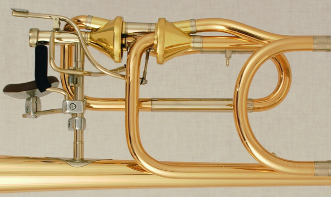 contrabass trombone with eb bb or c d attachment axial valves